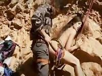 Sensational brunette fucks her rock climbing instructor in an awesome setting