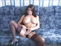 Brunette in stockings with natural tits rides high
