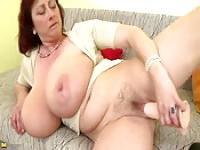 Monster boobs mom masturbates with toy