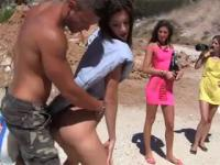 Teens have a wild sex orgy right on the beach