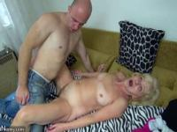 Fucking granny with strap-on