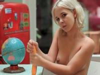 Innocent blonde Monroe teasing herself with a toy