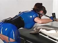 Latex Wearing Ginger Savage Readies Her Kinky Sex Table
