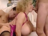 Huge tits blonde milf enjoyed two young big cocks