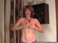 Mature redheaded housewife gets finger fucked by the photographer