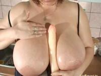blonde MILF with extreme big natural tits alone at home