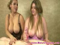 Busty blonde matures giving handjob to a lucky dude