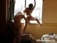 kinky couple fucking by the window