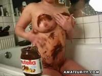 Busty amateur lesbians play with nutella in their bath