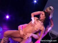Two strippers sharing cock gettign fucked on stage
