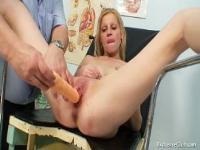 Gynecological pussy exam of naturaly big tits blonde