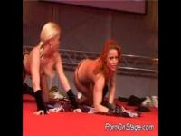 Nasty babes doing porn on stage touching hard tits
