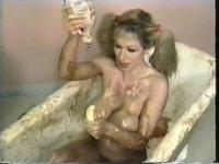 Sexy dirty blond whore takes bath in chocolate sauce and whipped cream