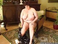 Fat granny with big breasts fucks a dildo