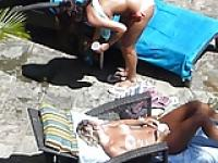 two hot girls topless by the pool in waikiki