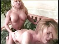 Blonde lesbians with BIG BOOBS and a strap-on! :)