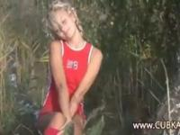 Ultra hot blonde fingering in a forest