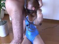 Bound girl in swimsuit is gagged and made to suck cock