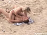 Peeping on a horny couple having sex at the beach
