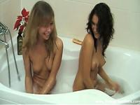 Fuck both chicks right in a bathtub