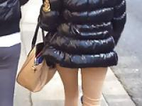 Candid street, skinny pants and shiny down jacket