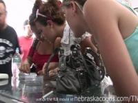 hot brunette college girl getting her nipples pierced on vacation