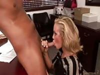 Sucking her boss' cock