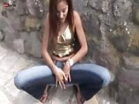 Slut masturbating in the middle of the street