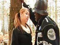 Girl fucks a black man in the forrest
