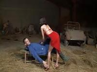 The woman in red fucks the farmer in the barn