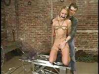 Blonde fucked by machines