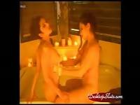 Two lesbians fuck by candlelight