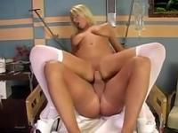 hot blonde busty nurse rides a dick