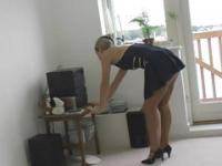 Girl in mini skirt stripping in the kitchen