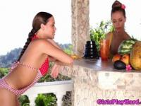 Lesbian stunners in bikinis eating out