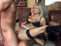 Blonde dped in black thigh high fishnet stockings