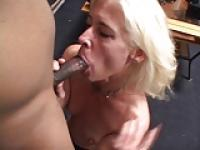 Blond MILF deep throats a big black cock