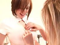 Hot teen nurses strip and caress in the bedroom