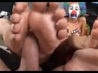 Hot clown double footjob.