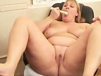 Alone playing in front of camera with her vibrator