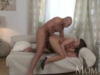 Sophisticated brunette with hairy pussy swallows a huge dick