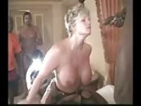 Interracial gangbang with a busty MILF 1
