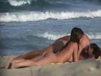 Young Couple On Nudist Beach