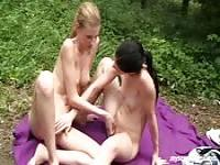 Girl on girl fun out in the woods