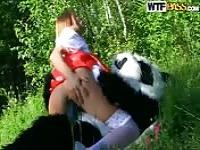 Innocent slut fucking a panda outdoors
