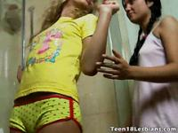 Precious teen lesbians Stephanie And Isabel licking their wet bodies in the shower