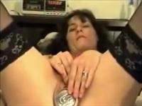 Amateur brunette shoves a beer can in her pussy