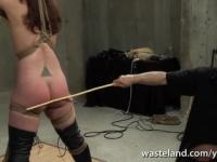 Brunette is tied and spanked by older dungeon master