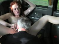 Pale redhead banged in fake taxi
