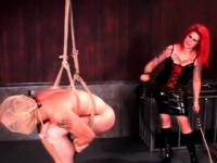 BDSM redhead mistress spanking male ass and hard balls